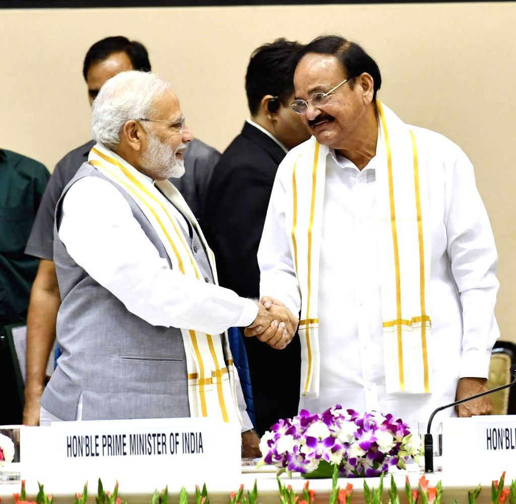 "Prime Minister Narendra Modi and Vice President and Rajya Sabha Chairman M. Venkaiah Naidu at the launch of ""Moving On... Moving Forward: A Year In Office"" - a book marking the ... - Narendra Modi and M. Venkaiah Naidu"