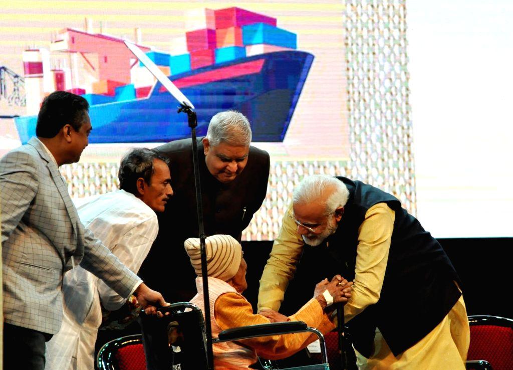 Prime Minister Narendra Modi and West Bengal Governor Jagdeep Dhankhar during the 150th anniversary celebrations of Kolkata Port Trust, in Kolkata on Jan 12, 2020. - Narendra Modi