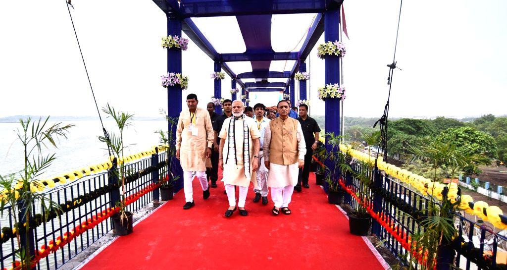 Prime Minister Narendra Modi arrives at ceremony to inaugurate Aji-3 Dam under Phase-I of Saurashtra Narmada Avtaran Irrigation (SAUNI) Yojana in Rajkot on June 29, 2017. Also seen Gujarat ... - Narendra Modi