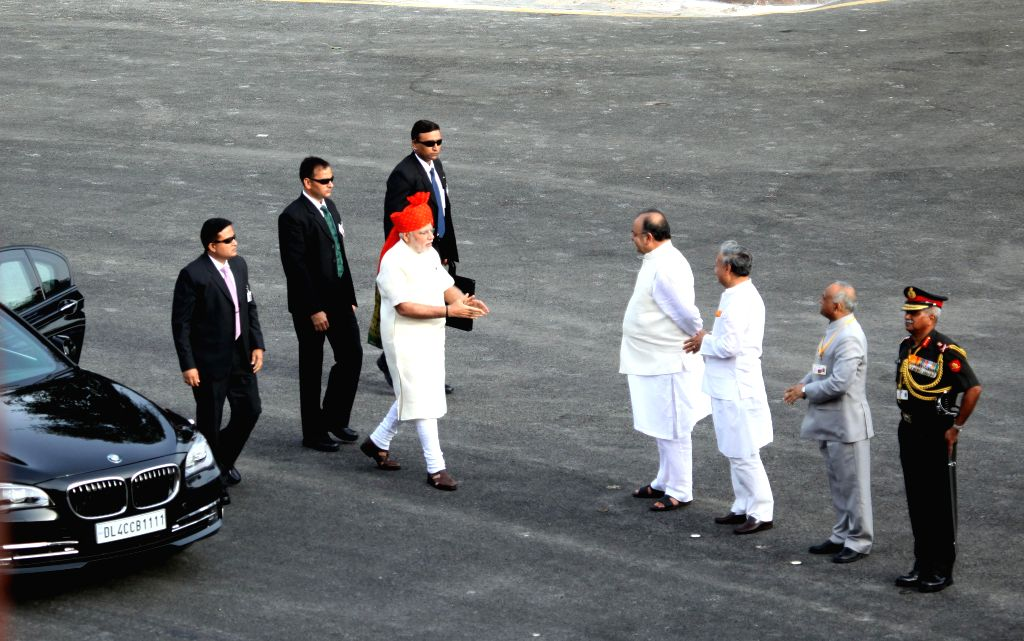 Prime Minister Narendra Modi arrives at Red Fort to hoist the national flag and address the nation on Independence Day in New Delhi on Aug 15, 2014. Also seen Union Minister for Finance, Corporate ... - Narendra Modi, Arun Jaitley and Rao Inderjit Singh