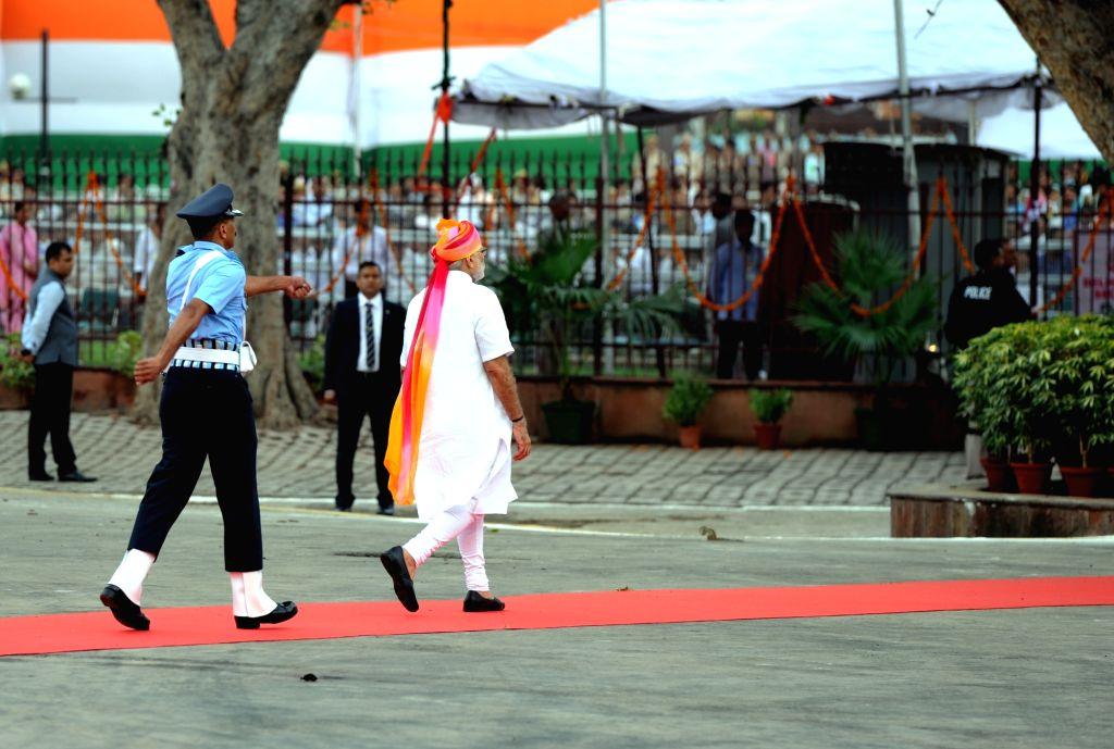 Prime Minister Narendra Modi arrives at Red Fort to address the nation on Independence Day, in Delhi on Aug 15, 2016. - Narendra Modi
