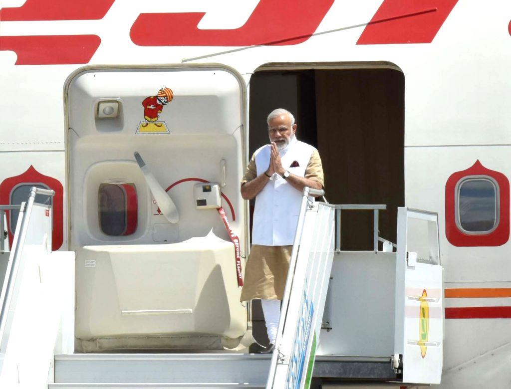 Prime Minister Narendra Modi arrives at Tashkent International Airport in Uzbekistan on June 23, 2016. - Narendra Modi
