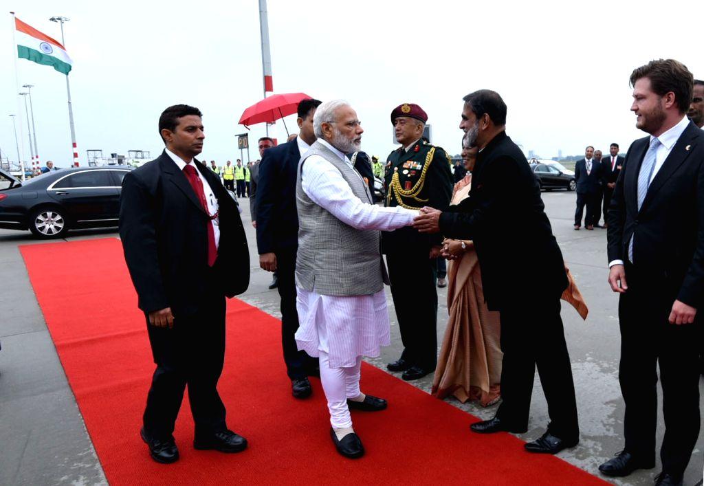 Prime Minister Narendra Modi arrives in Delhi after successful visit to Portugal, USA and Netherlands, on June 28, 2017. - Narendra Modi