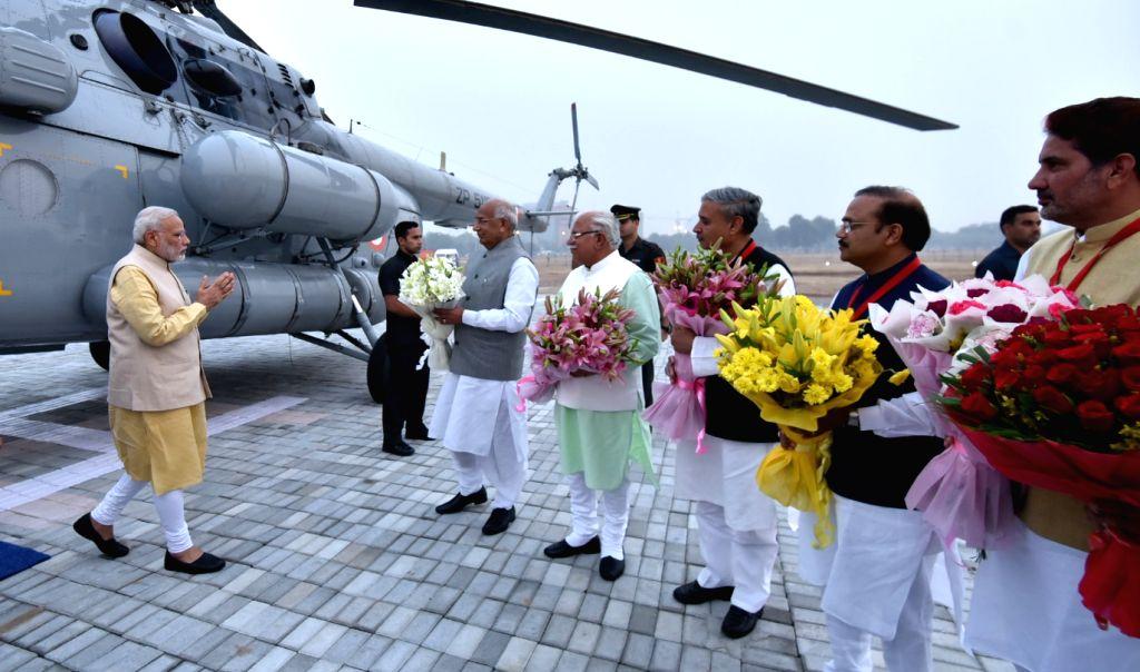 Prime Minister Narendra Modi arrives in Gurugram for Haryana Swarna Jayanti Celebrations in Haryana on Nov 1, 2016. Haryana Governor Prof. Kaptan Singh Solanki, Chief Minister Manohar Lal ... - Narendra Modi, Kaptan Singh Solanki and Manohar Lal Khattar