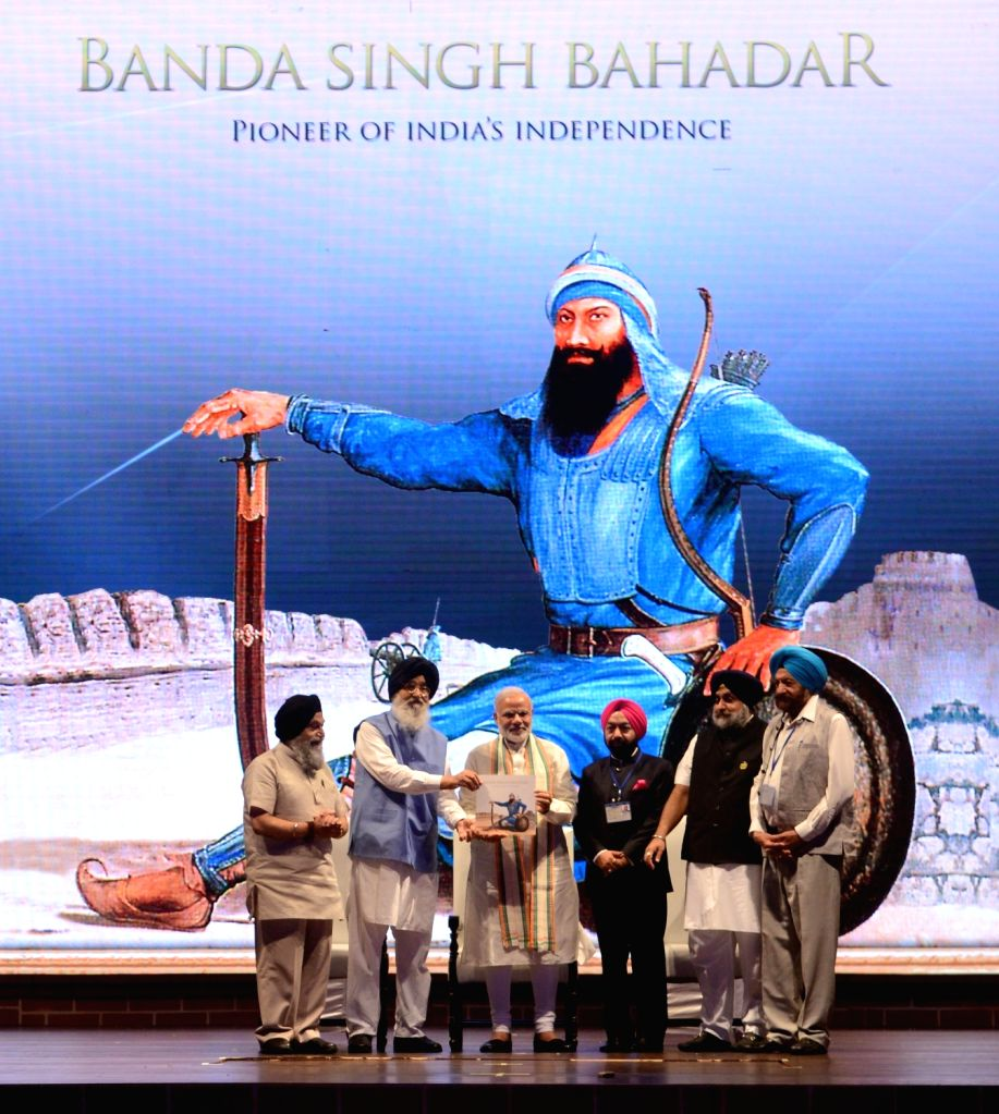 Prime Minister Narendra Modi at a commemorative event organised to mark 300th Martyrdom Anniversary of Baba Banda Singh Bahadurji, in New Delhi on July 3, 2016. Also seen Punjab Chief ... - Narendra Modi, Banda Singh Bahadurji, Parkash Singh Badal and Sukhbir Singh Badal