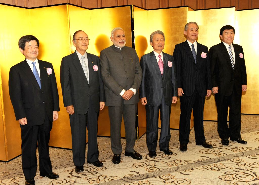 Prime Minister Narendra Modi at the Business luncheon hosted by Nippon Kiedanren - the Japanese Chamber of Commerce and Industry, and the Japan-India Business Cooperation Committee, in Tokyo, Japan .. - Narendra Modi