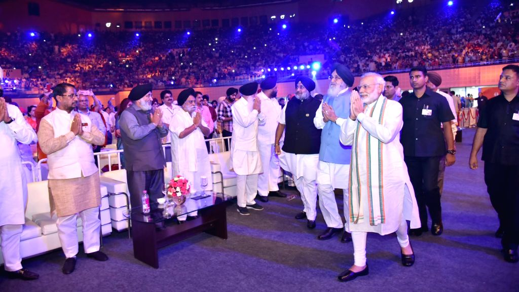 Prime Minister Narendra Modi at the commemorative event to mark 300th Martyrdom Anniversary of Baba Banda Singh Bahadurji, in New Delhi on July 3, 2016. Also seen Punjab Chief Minister ... - Narendra Modi, Banda Singh Bahadurji, Parkash Singh Badal and Sukhbir Singh Badal