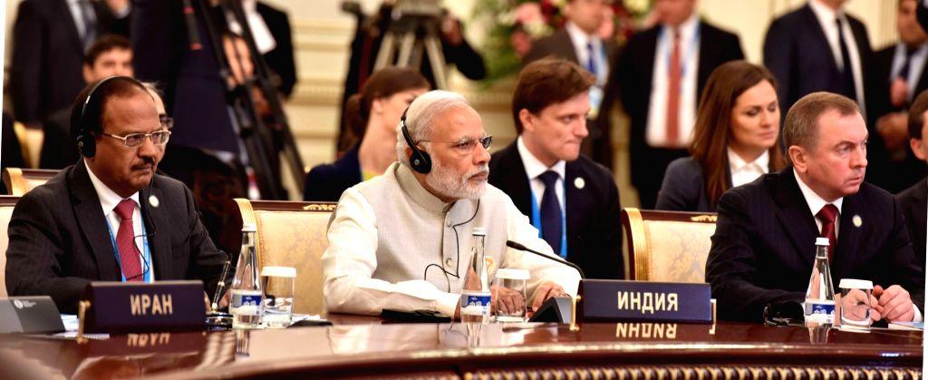 Prime Minister Narendra Modi at the extended meeting of the Member States and Observer countries, in Tashkent, Uzbekistan on June 24, 2016. - Narendra Modi