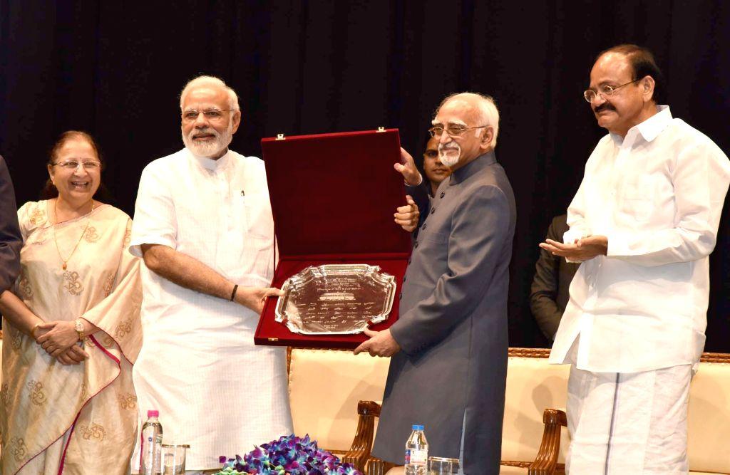 Prime Minister Narendra Modi at the farewell function of the Vice President M Hamid Ansari at Parliament in New Delhi on August 10, 2017. Also seen Vice President-elect M Venkaiah Naidu ... - Narendra Modi, M Venkaiah Naidu and Sumitra Mahajan