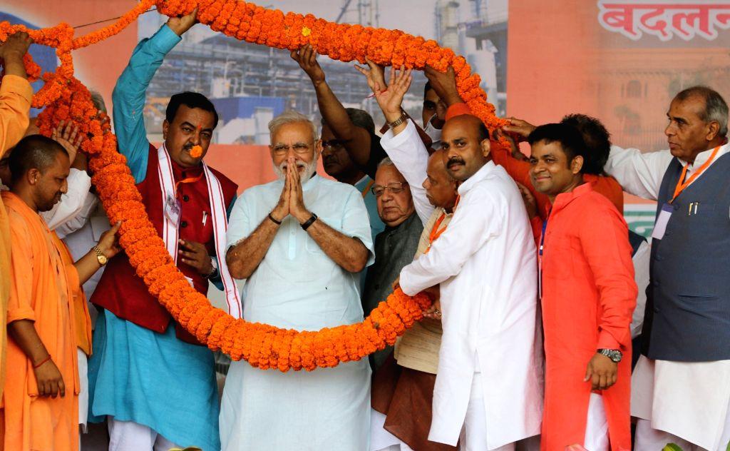 Prime Minister Narendra Modi at the foundation stone laying ceremony of the AIIMS Gorakhpur & for the revival of Gorakhpur Fertilizer plant, at Sports Ground, FCI, in Gorakhpur, Uttar ... - Narendra Modi