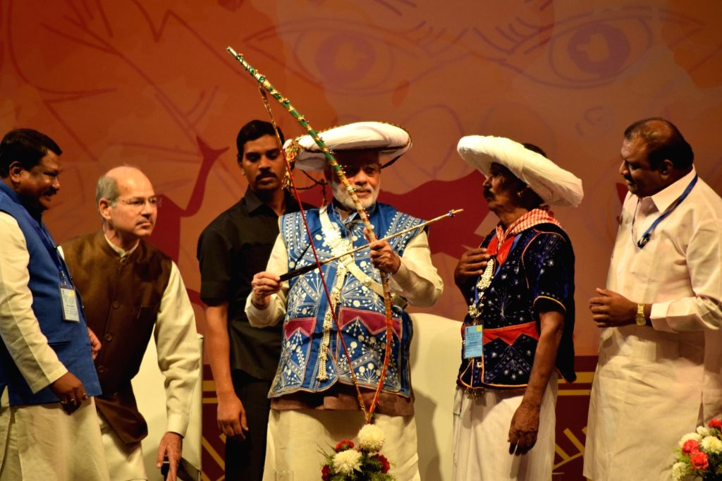 Prime Minister Narendra Modi at the inauguration of National Tribal Carnival-2016, in New Delhi on Oct 25, 2016. - Narendra Modi