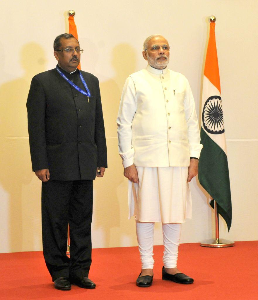 Prime Minister Narendra Modi at the reception hosted by the Ambassador of India in United Arab Emirates (UAE) TP Seetharam, in Dubai on Aug 17, 2015. - Narendra Modi