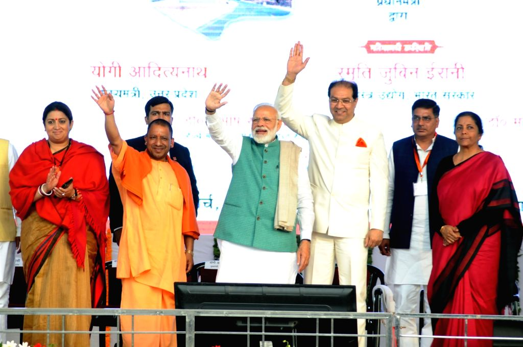 Prime Minister Narendra Modi at the unveiling of the various development projects in Amethi, Uttar Pradesh on March 3, 2019. Also seen Union Ministers Nirmala Sitharaman, Smriti Irani and ... - Narendra Modi, Nirmala Sitharaman, Smriti Irani and Uttar Pradesh Chief Minister Yogi Adityanath