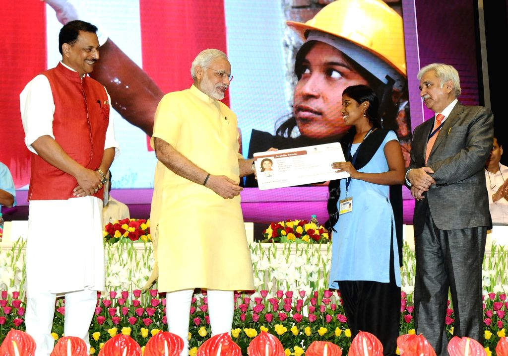 Prime Minister Narendra Modi award the certificates to successful trainees under Pradhan Mantri Kaushal Vikas Yojna (PMKVY), on the occasion of the World Youth Skills Day, in New Delhi on ... - Narendra Modi and Sunil Arora