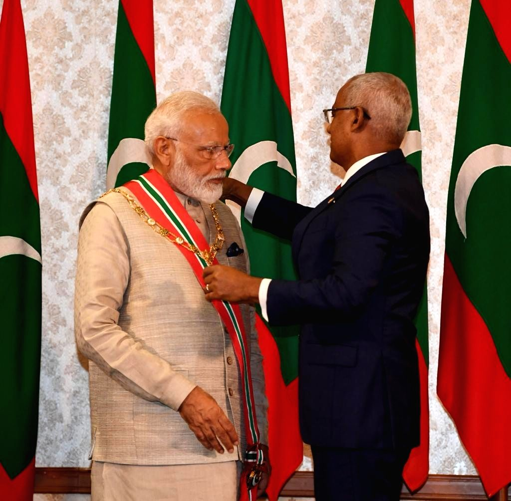 Prime Minister Narendra Modi being conferred Maldives' highest honour for foreign dignitaries'Order of the Distinguished Rule of Nishan Izzuddeen Maldives by President Ibrahim Mohammad ... - Narendra Modi