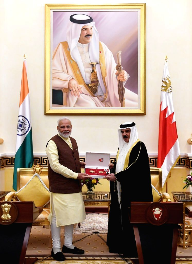 Prime Minister Narendra Modi being conferred 'The King Hamad Order of the Renaissance' by Bahrain King Hamad bin Isa Al Khalifa at the Al Gudaibiya Palace in Manama, Bahrain on Aug 25, 2019. - Narendra Modi