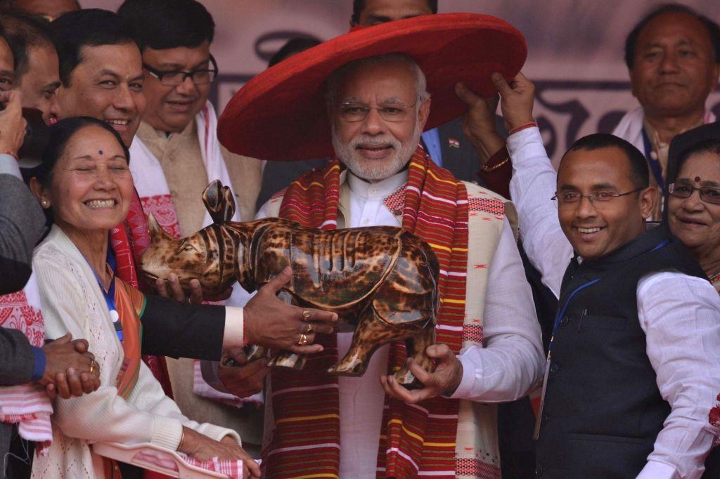 Prime Minister Narendra Modi being felicitated during Yuva Maha Shakti Samaroh in Guwahati, on Jan 19, 2016. - Narendra Modi