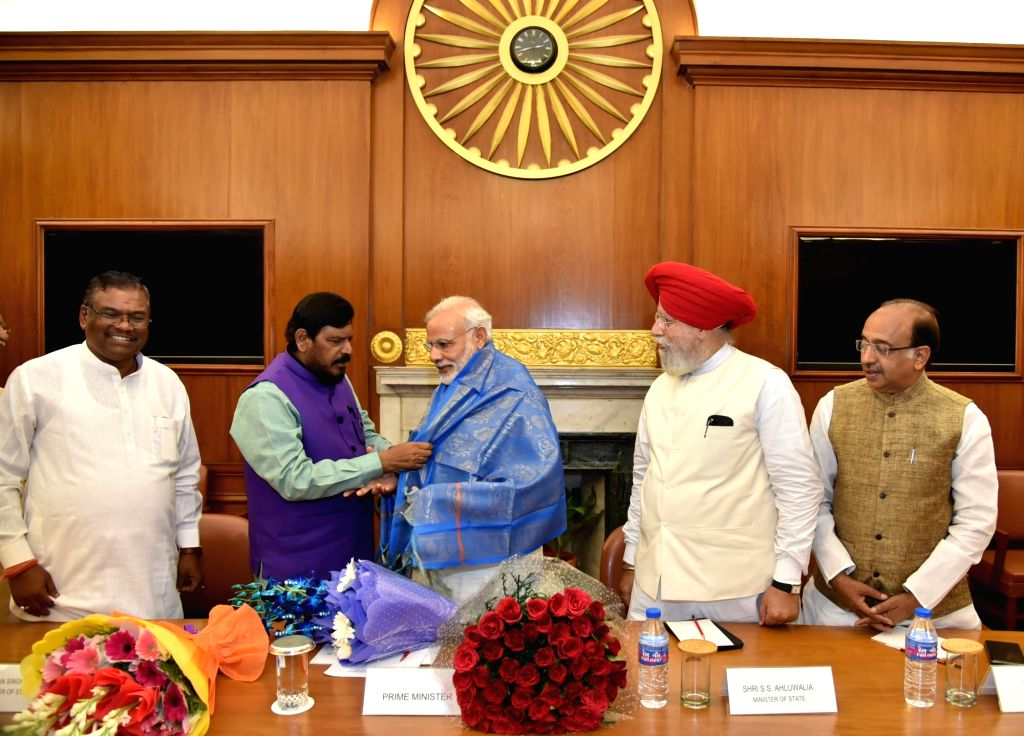 Prime Minister Narendra Modi being felicitated by Union MoS Ramdas Athawale during a meeting in New Delhi on July 5, 2016. - Narendra Modi