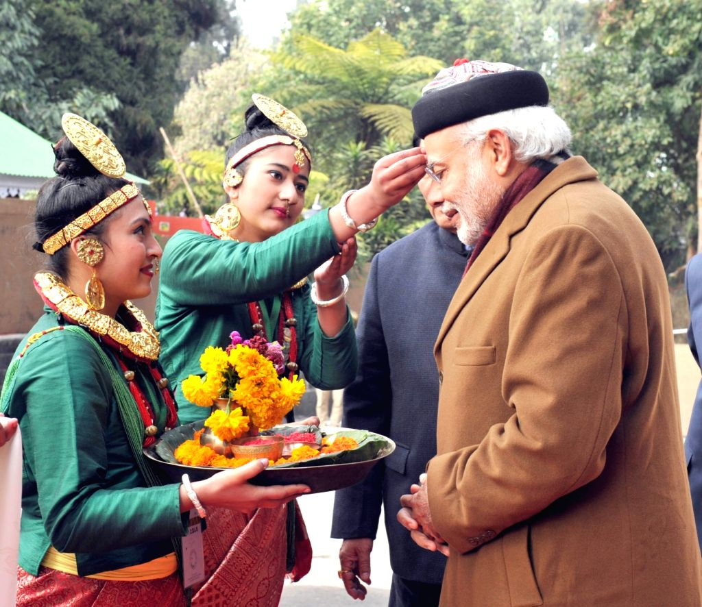 Prime Minister Narendra Modi being given a traditional welcome on his arrival, in Gangtok, on Jan 18, 2016. - Narendra Modi