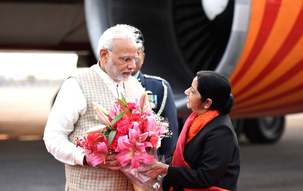 Prime Minister Narendra Modi being greeted by External Affairs Minister Sushma Swaraj as he arrives in New Delhi after concluding his 4-day visit to Jordan, Palestine, UAE and Oman; on Feb ... - Narendra Modi and Sushma Swaraj