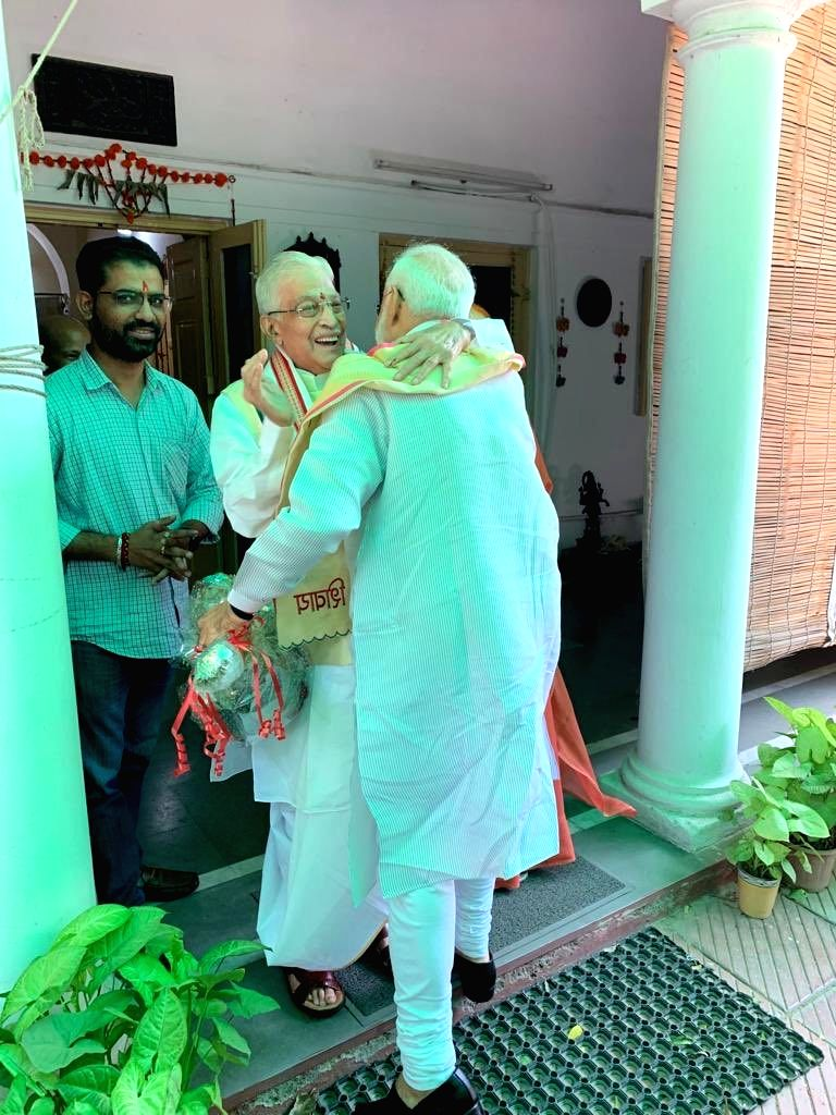 Prime Minister Narendra Modi being greeted by senior BJP leader Murli Manohar Joshi on the PM's arrival to meet him, in New Delhi on May 24, 2019. The BJP on Thursday recorded a stunning ... - Narendra Modi and Murli Manohar Joshi