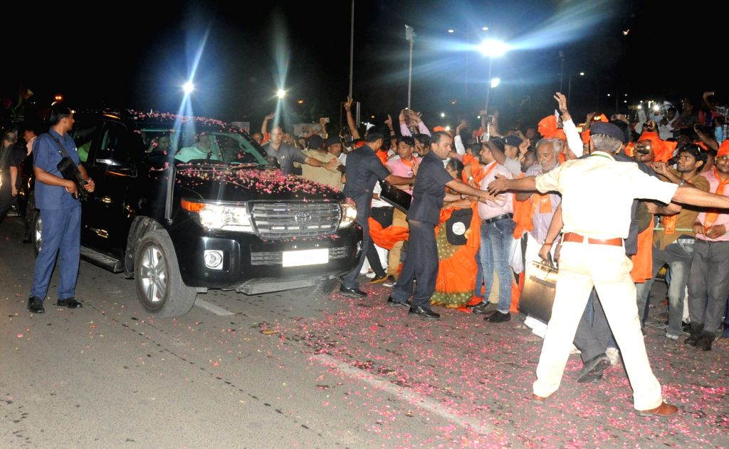 Prime Minister Narendra Modi being greeted by his supporters in Ahmedabad, on May 22, 2017. - Narendra Modi