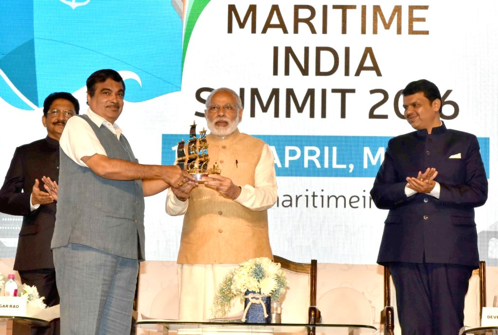 Prime Minister Narendra Modi being presented a memento by Union Minister for Road Transport & Highways and Shipping Nitin Gadkari, at the Maritime India Summit, in Mumbai on April 14, ... - Narendra Modi