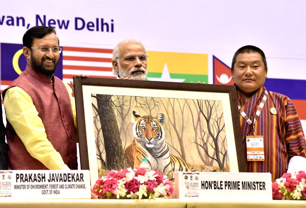 Prime Minister Narendra Modi being presented the memento by the Minister of State for Environment, Forest and Climate Change (Independent Charge) Prakash Javadekar during the 3rd Asia ... - Narendra Modi