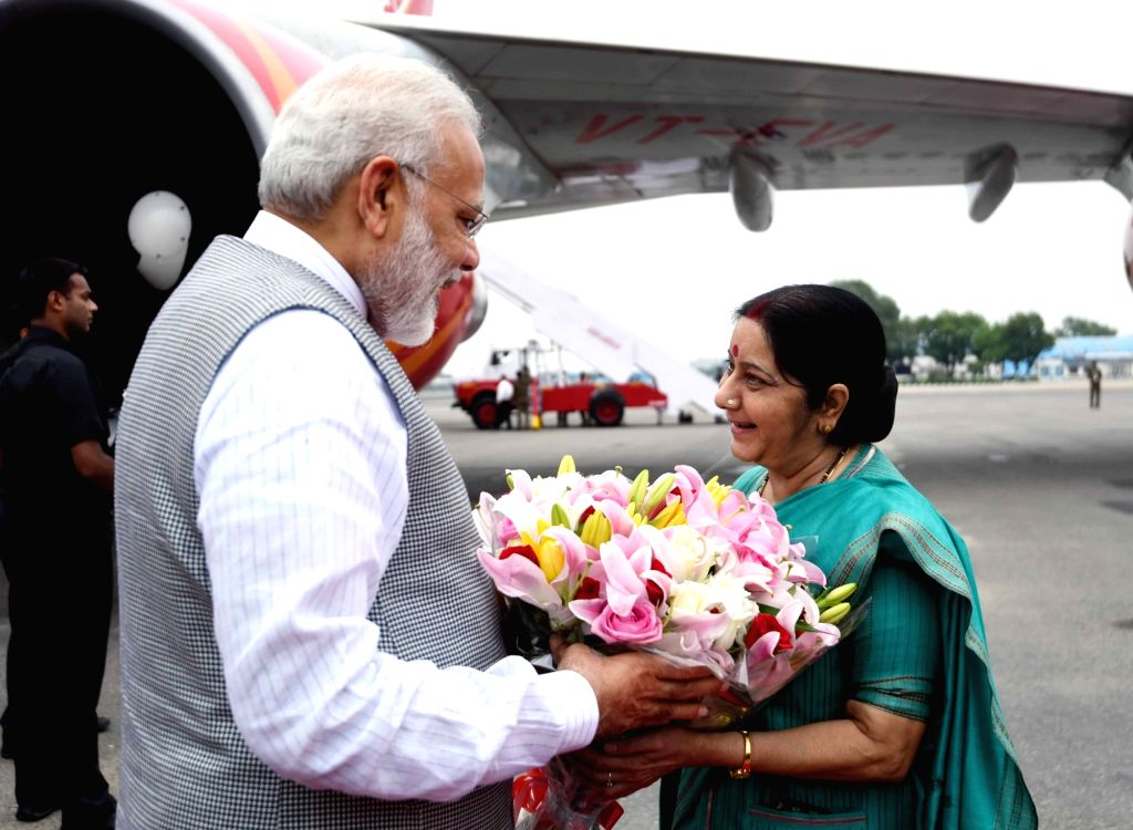 Prime Minister Narendra Modi being received by the Union Minister for External Affairs Sushma Swaraj, on his arrival to Delhi after successful visit to Portugal, USA and Netherlands, on ... - Narendra Modi and Sushma Swaraj