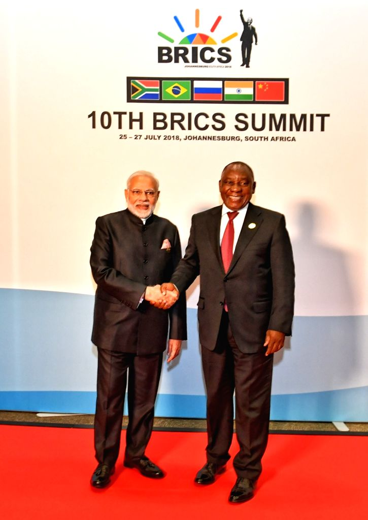 Prime Minister Narendra Modi being received by South African President Cyril Ramaphosa ahead of the 10th BRICS Summit at the Sandton International Convention Centre in Johannesburg, ... - Narendra Modi