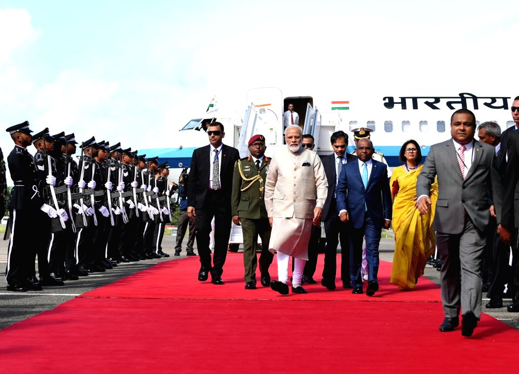 Prime Minister Narendra Modi being received by Maldives Foreign Minister Abdulla Shahid on his arrival in Male, on June 8, 2019. - Narendra Modi