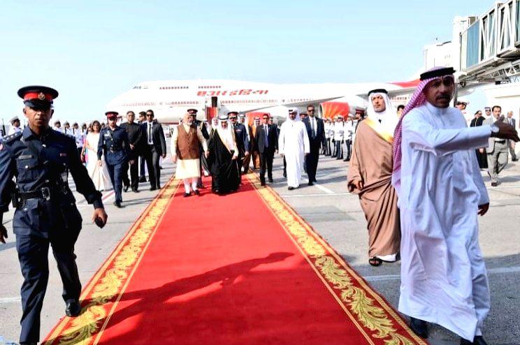 Prime Minister Narendra Modi being received by Bahrain Prime Minister Khalifa bin Salman Al Khalifa on his arrival in Manama, Bahrain on Aug 24, 2019. - Narendra Modi
