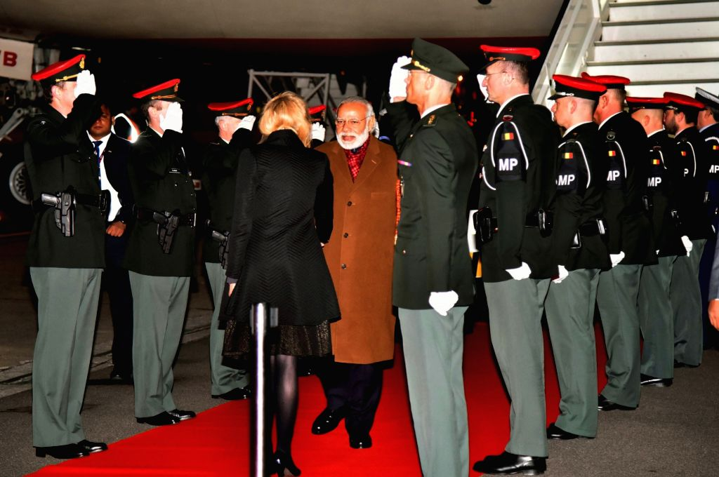 Prime Minister Narendra Modi being received on his arrival at Brussels Military Airport, Belgium on March 30, 2016. - Narendra Modi