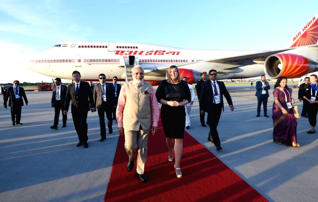 Prime Minister Narendra Modi being received on his arrival at the Helmut Schmidt Airport, Hamburg, to attend the G20 Summit, in Germany on July 06, 2017. - Narendra Modi