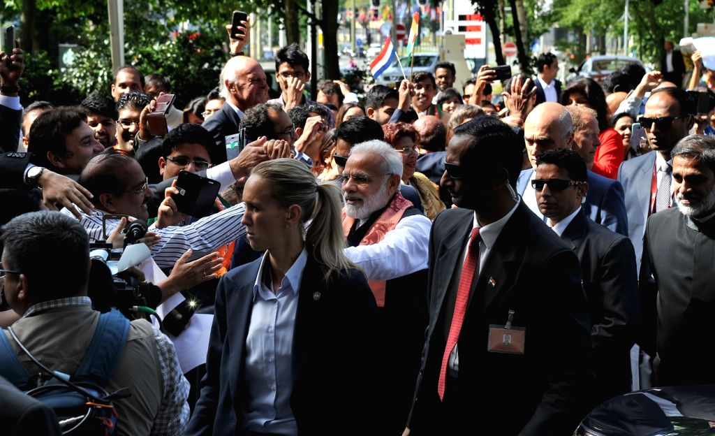 Prime Minister Narendra Modi being warmly welcomed by the people on his arrival at Amsterdam, Netherlands on June 27, 2017. - Narendra Modi