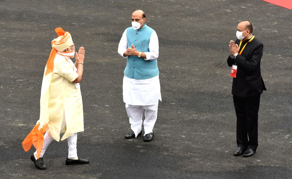 Prime Minister Narendra Modi being welcomed by Defence Minister Rajnath Singh on his arrival at the Red Fort during the 74th Independence Day celebrations, in Delhi on Aug 15, 2020. - Narendra Modi and Rajnath Singh