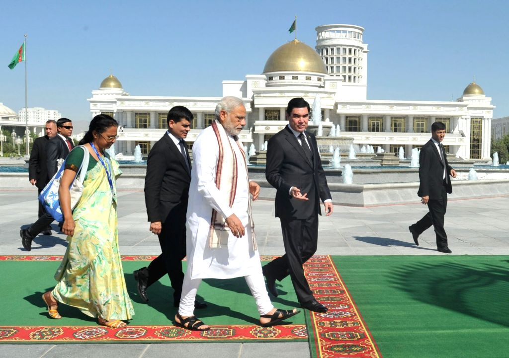 Prime Minister Narendra Modi being welcomed by the President of Turkmenistan Gurbanguly Berdimuhamedov, at Independence Square, in Oguzkhan Palace, Ashgabat, Turkmenistan on July 11, 2015. ... - Narendra Modi