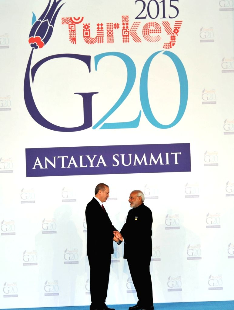 Prime Minister Narendra Modi being welcomed by the Turkey President Recep Tayyip Erdogan, at the G20 Turkey 2015, in Antalya, Turkey on Nov 15, 2015. - Narendra Modi