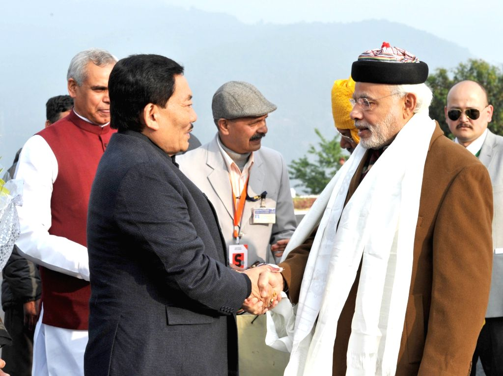 Prime Minister Narendra Modi being welcomed by the Sikkim Chief Minister Pawan Kumar Chamling on his arrival, in Gangtok, on Jan 18, 2016. - Narendra Modi and Pawan Kumar Chamling
