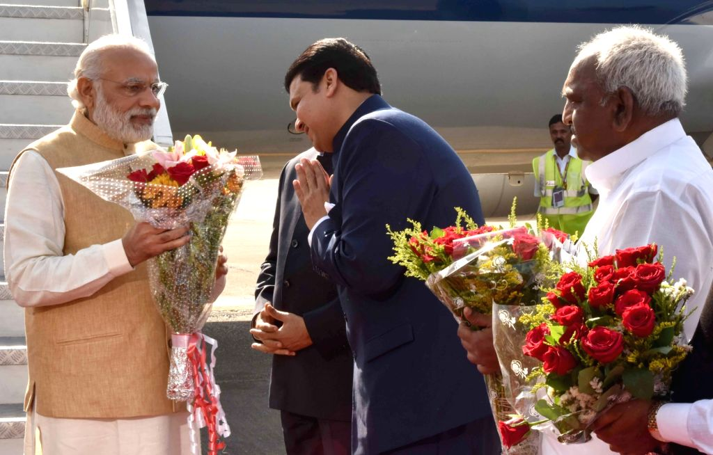 Prime Minister Narendra Modi being welcomed by the Chief Minister of Maharashtra, Devendra Fadnavis, on his arrival in Mumbai on April 14, 2016. The Minister of State for Road Transport & ... - Narendra Modi