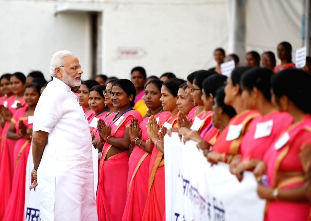 Prime Minister Narendra Modi being welcomed by the Anganwadi workers during a programme, in Varanasi, Uttar Pradesh, on Sept 17, 2018. - Narendra Modi