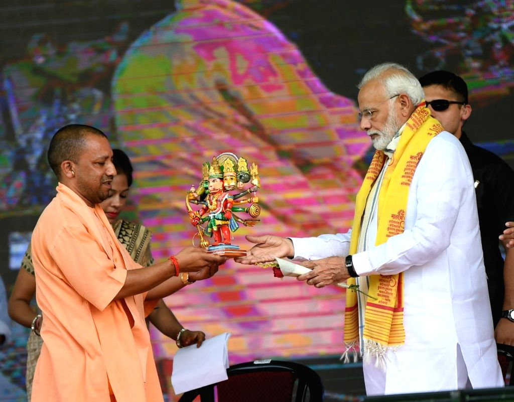 Prime Minister Narendra Modi being welcomed by Uttar Pradesh Chief Minister Yogi Adityanath at the foundation stone laying ceremony of various development projects, in Varanasi on Sept 18, ... - Narendra Modi