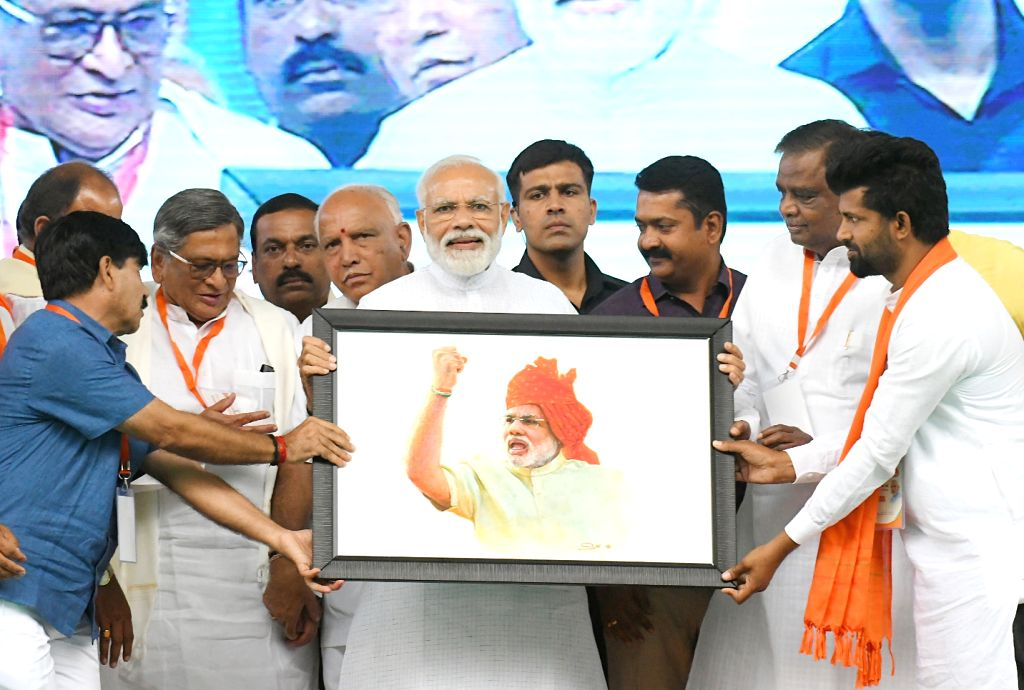 Prime Minister Narendra Modi being welcomed by BJP workers during a public rally in Mysuru, Karnataka on April 9, 2019. Also seen BJP leaders B.S. Yeddyurappa and S.M.Krishna. - Narendra Modi
