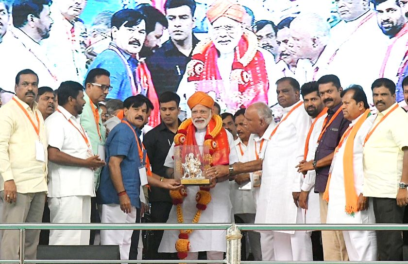 Prime Minister Narendra Modi being welcomed by Karnataka BJP President B.S. Yeddyurappa and other leaders of the party during a public rally in Mysuru, Karnataka on April 9, 2019. - Narendra Modi