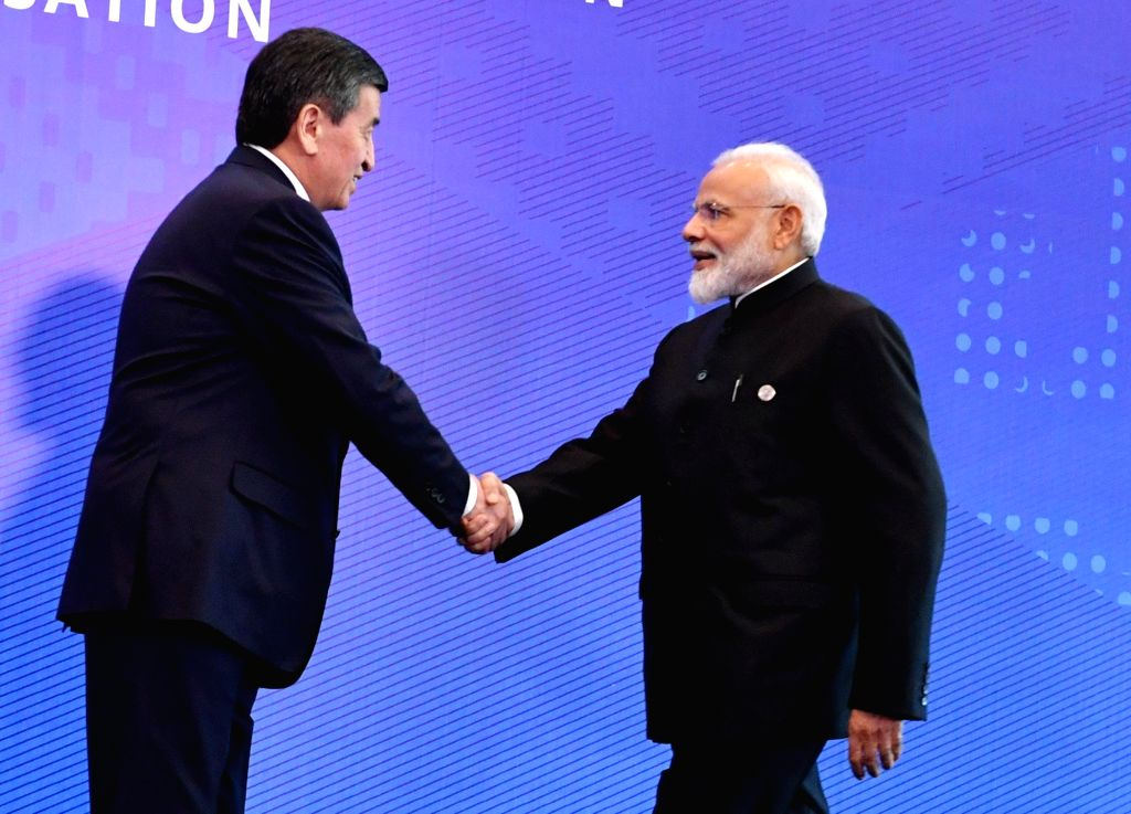 Prime Minister Narendra Modi being welcomed by Kyrgyzstan President Sooronbay Jeenbekov on his arrival at the Ala Archa Presidential Palace ahead of the SCO Council of Heads of State Meeting ... - Narendra Modi