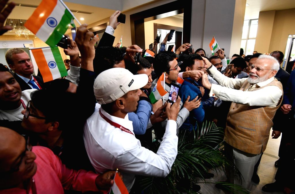 Prime Minister Narendra Modi being welcomed by the Indian Community on his arrival at Vladivostok airport in Russia on Sep 4, 2019. - Narendra Modi