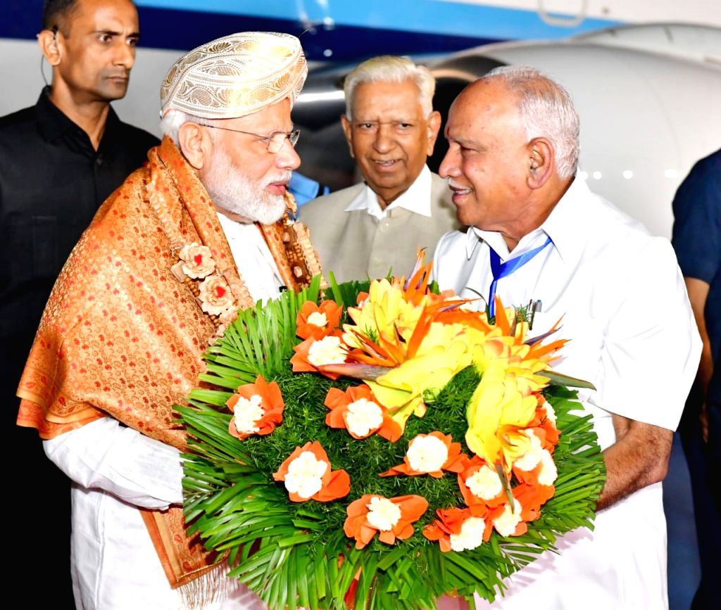 Prime Minister Narendra Modi being welcomed by Karnataka Governor Vajubhai R Vala and Chief Minister of BS Yeddiyurappa, in Bengaluru on Sep 6, 2019. - Narendra Modi