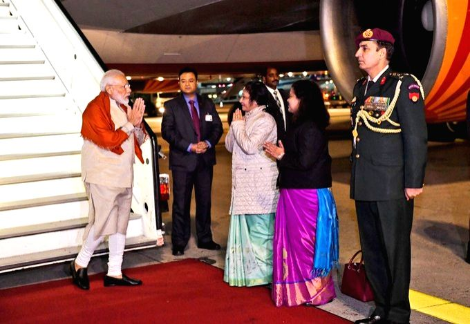Prime Minister Narendra Modi being welcomed by Indian Ambassador to Germany Mukta Dutta Tomar and Consul General Pratibha Parkar during a two-hour technical halt in Frankfurt, Germany on ... - Narendra Modi