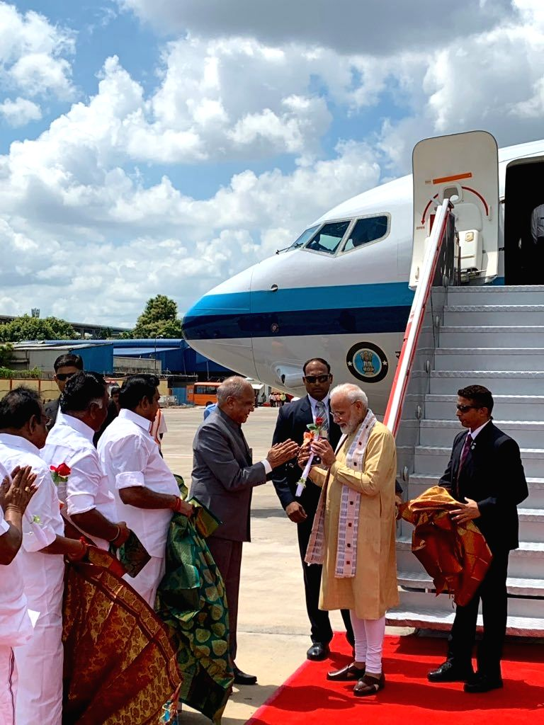 Prime Minister Narendra Modi being welcomed by Tamil Nadu Governor Banwarilal Purohit and Chief Minister Edappadi K. Palaniswami on his arrival in Chennai, ahead of an Informal Summit ... - Narendra Modi