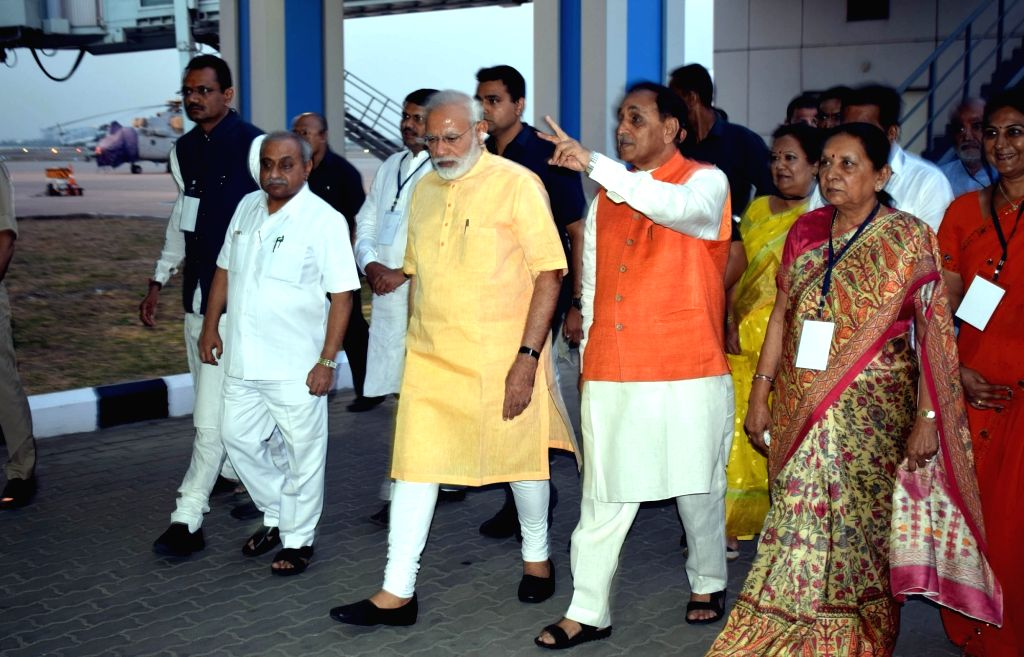 Prime Minister Narendra Modi being welcomed in Surat by Gujarat Chief Minister Vijay Rupani, Deputy Chief Minister Nitin Patel and former Chief Minister Anandiben Patel on April 16, 2017. - Narendra Modi, Nitin Patel and Anandiben Patel